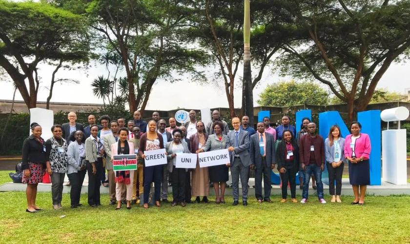 Representatives of 18 Kenyan universities met at the UN compound in Nairobi in June 2019 to agree a new plan of action including greening campus operations while also enhancing student engagement and learning.  Holding the word NETWORK is Prof. P. Aloo-Obudho ( DVC-ARSA) and a colleague from UNEP. Photo by Carina Mutschele.
